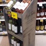 Wine rack visual decor and retail store signage and POP kits for Hannaford from top premier sign company specializing in ADA guidelines.