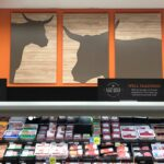 Retail Store Signage, and POP kits for Hannaford meat department from top premier sign company specializing in ADA guidelines.